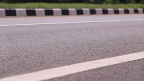 De weg van het asfalt stock footage