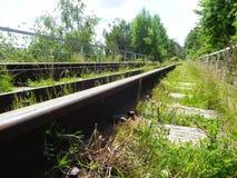 De weg van de spoorweg De spoorwegpassen door mooie landschappen Details en close-up stock foto