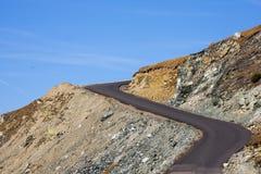 De weg van Transalpina stock foto's
