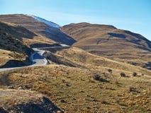 De weg van Windling, heuvelland Nieuw Zeeland. Stock Afbeeldingen