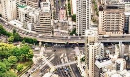 De wegkruising en gebouwen van Tokyo Stock Foto