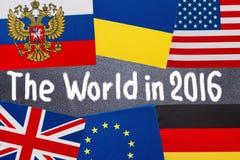 De wereld in de tekst van 2016 op bord wordt geschreven dat Stock Fotografie