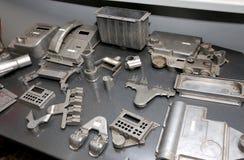 De werkstukken van het pakhuismetaal en materiaal verouderde mechanische pla Stock Afbeeldingen