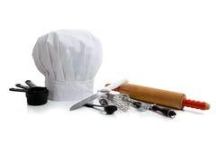 De werktuigen van het baksel met de hoed van een chef-kok