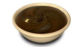 De Werveling van de chocolade in een Kom stock foto's