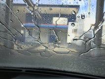 De Werveling van het autowasserettewater Stock Foto