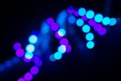 De werveling van het Duotoneneon van bokehlichten op zwarte Abstracte achtergrond voor uw ontwerp royalty-vrije stock afbeeldingen