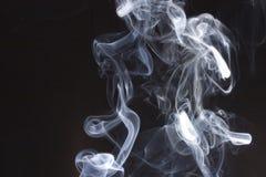 De wervelingen van de rook Stock Foto's