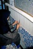 De wever van het tapijt Stock Foto
