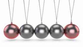 De wieg van Newton ` s, het is een apparaat dat behoud van impuls en energie gebruikend een reeks van het slingeren van gebieden  Stock Foto