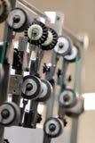 De wielen van de technologie Stock Foto's