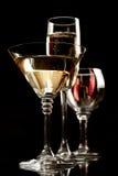 De wijn en martini van Champagne glazen Royalty-vrije Stock Afbeeldingen