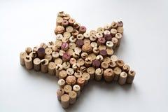 De wijn kurkt stersilhouet op witte achtergrond stock foto