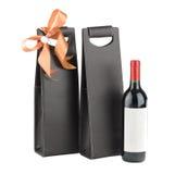 De wijnzak van het leer en wijnfles stock foto's