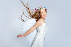 De wind van het de kinderenmeisje van de engel in haar Stock Foto's