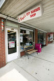 De Winkel van de kapper in Luchtig Onderstel stock fotografie