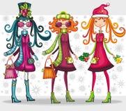 De winkelende meisjes van Kerstmis Stock Foto's