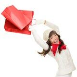 De winkelende vrouw van de winter en van Kerstmis Stock Foto's