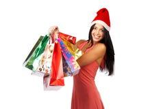 De winkelende vrouw van Kerstmis Stock Foto's