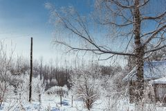 De winter in het dorp royalty-vrije stock afbeeldingen
