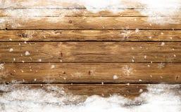 De winter houten achtergrond met sneeuw Royalty-vrije Stock Afbeeldingen