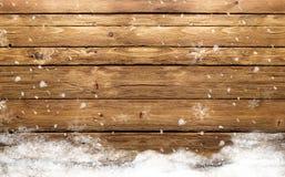 De winter houten achtergrond met sneeuw Royalty-vrije Stock Foto's