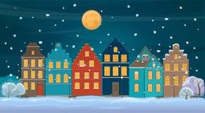De winterachtergrond met oude stad bij nacht Stock Foto's