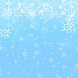 De winterachtergrond met sneeuw en sneeuwvlokken Stock Afbeelding