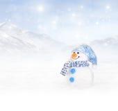 De winterachtergrond met sneeuwman Stock Fotografie