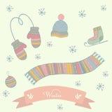De winterkleren geplaatst sjaal, vuisthandschoenen, hoed, schaatsen Royalty-vrije Stock Afbeeldingen