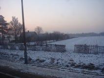 De winterlandschap bij dageraad Stock Afbeelding
