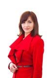 De wintermeisje in rode laag over witte achtergrond royalty-vrije stock fotografie