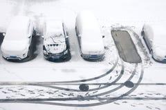De winterparkeerterrein Stock Foto's
