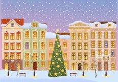 De winterstad met Kerstmisboom Stock Afbeelding