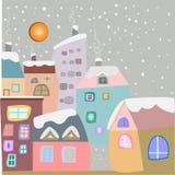 De winterstad Sneeuwhuizen in pastelkleuren Stock Foto