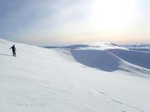 De winterzon over Glas Maol, Glenshee, Hooglanden, Schotland stock foto's