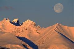 De winterzonsopgang met Maan Royalty-vrije Stock Afbeelding