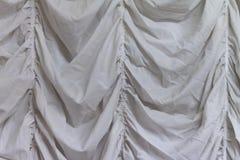 De witte achtergrond van de stoffentextuur, golvende stof royalty-vrije stock foto's