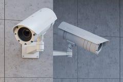 De witte camera's op een grijze muur sluiten omhoog Royalty-vrije Stock Fotografie
