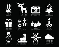De witte die pictogrammen van de Kerstmiswinter op zwarte worden geplaatst Stock Afbeelding