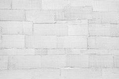 De witte gestreepte achtergrond van de muurtextuur Stock Afbeelding