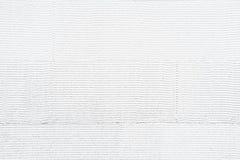 De witte gestreepte achtergrond van de muurtextuur Royalty-vrije Stock Afbeeldingen