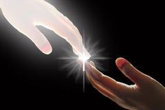De witte Gods` s Hand raakt de Hand met Kruis Royalty-vrije Stock Afbeeldingen