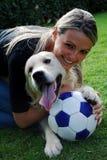 De witte hond van het voetbal Royalty-vrije Stock Afbeelding