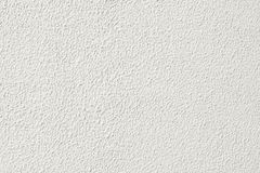 De witte korrelige textuur van de pleistermuur royalty-vrije stock foto