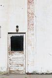 De witte muur van de deur stock fotografie