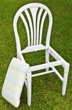 De Witte Stoel van Uncomplete met Stootkussen Stock Foto
