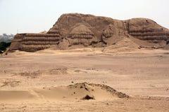 De woestijn en de ruïnes van het zand Stock Foto