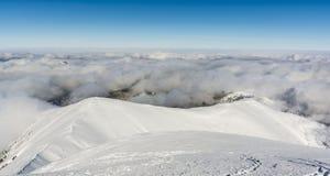 De wolken behandelen de laaglanden Stock Foto's
