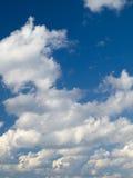 De wolken van de cumulus stock foto's